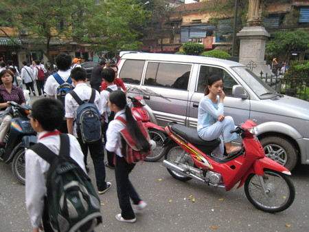 Hanoi_girl_in_pj_on_bike_2