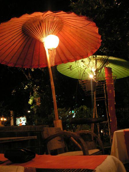 Chiang_mai_antique_house_porch_umbrellas